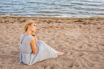 fashion photo of beautiful happy woman at sea. Beach travel. Summer