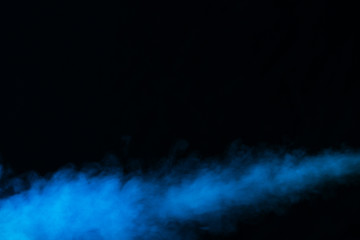 jet of steam from an electronic cigarette on a dark background