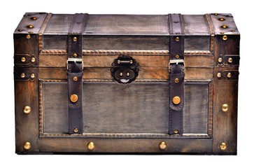 Old wooden chest with ornamental forging and leather straps isolated on white background