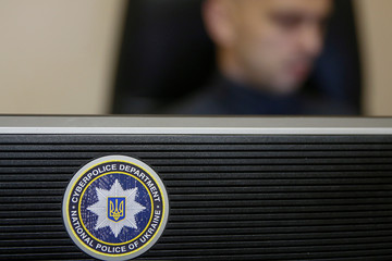 The logo of the Ukrainian Cyber Police is seen on a monitor at its headquarters in Kiev