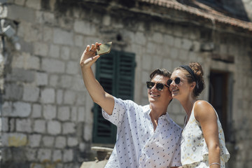 Couple Taking Selfie With Cell Phone