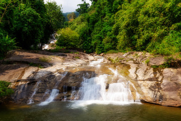 Water fall in forest with green tree landscape