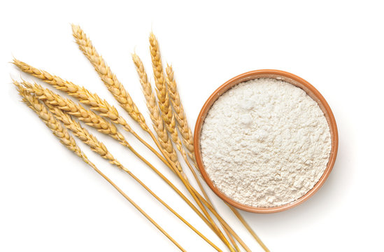 Top view of wheat flour and  ears