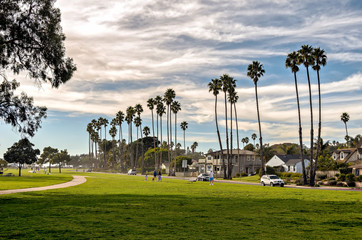 People enjoy a walk along Shoreline park in Santa Barbara, California.
