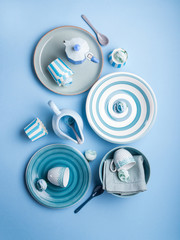 Blue pastel ceramic tableware crockery set on abstract background