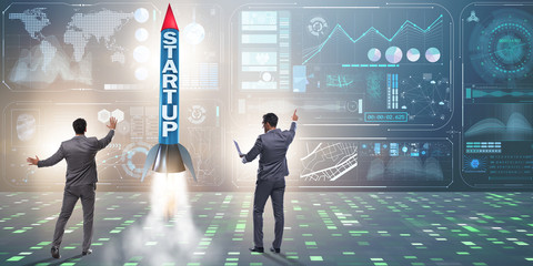Start-up concept with rocket and businessman