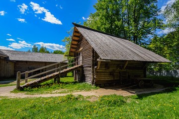 Ancient wooden log horse barn.