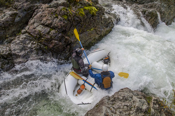 Whitewater rafters dropping into Thors Playroom rapid on section of upper Little North Santiam River in Opal Creek Wilderness, Oregon, USA