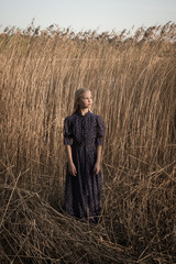 Girl standing in field