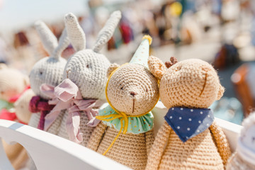 small knitted baby toys for sale at outdoor handmade market