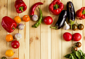 Fresh vegetables, only from the garden. Top view, on a wooden background