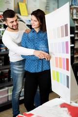 Couple examining color scheme variants