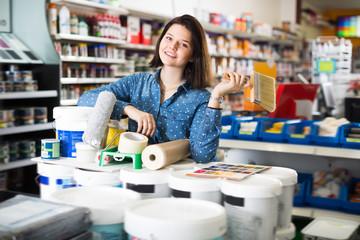 Adult girl demonstrating tools for renovating