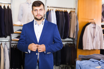 man  choosing  fashion jacket