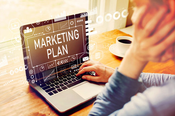 Marketing plan with man using a laptop computer