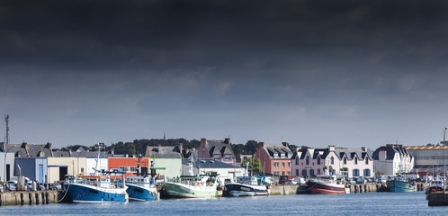 Stormy landscape of the main harbor in low tide, Guilvinec, Brittany, France