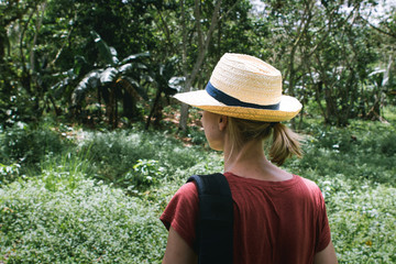 Woman with a Hat looking into the jungle