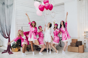 Bridesmaids and bride having fun at bachelorette party.