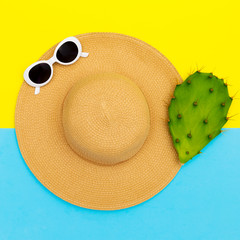 Stylish straw hat and sunglasses. Beach fashion vibes