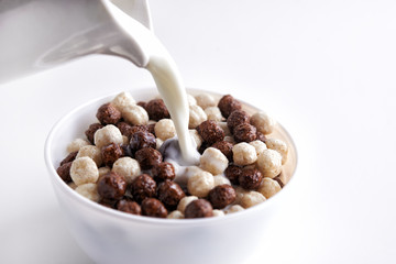 Chocolate cereal balls and milk