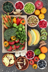 Super food concept with fruit, vegetables, herbs and spice. Foods high in fibre, anthocyanins, antioxidants, minerals and vitamins.