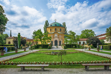 Munich, Germany - June 09, 2018: Chapel of famous West cemetery of Munich, Germany with historic gravestones