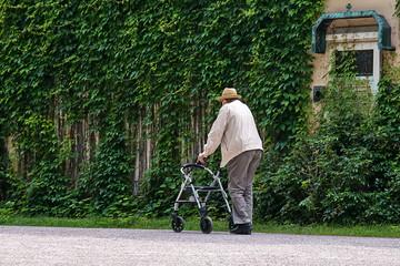Munich, Germany - June 09, 2018: Senior walk in the cemetery