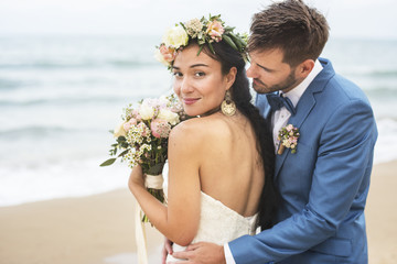 Young couple getting married at the beach