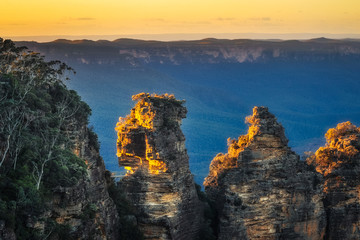 First sunrays in the morning at Three Sisters in Blue Mountains, Katoomba, Australia