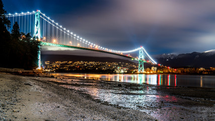 Lions Gate Bridge, long exposure on a foggy night. Vancouver, British Columbia, Canada.