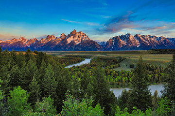 Sunrise view of the Grand Tetons from the Snake River overlook in Jackson Hole, Wyoming.