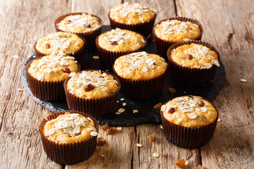 Organic food: oatmeal muffins with raisins close-up on a slate plate on a table. horizontal
