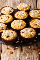Homemade muffins of oatmeal with raisins close-up on the table. vertical, rustic style