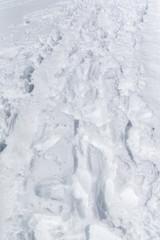 fresh footprints in the snow.