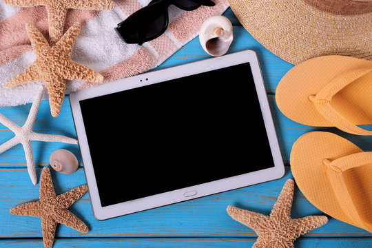 Tablet pc computer summer beach background