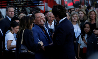"""Cast members Brolin and Del Toro greet each other at the premiere for the movie """"Sicario: Day of the Soldado"""" in Los Angeles"""