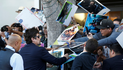 "Cast member Del Toro signs autographs at the premiere for the movie ""Sicario: Day of the Soldado"" in Los Angeles"