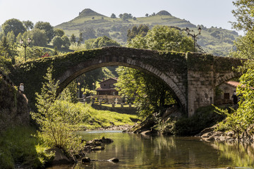 Lierganes, Cantabria. Views of the Puente Romano Viejo (Old Roman Bridge) and the Tetas de Lierganes twin mountains. One of the most beautiful towns in Spain