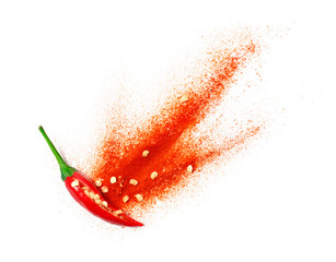 Poster de jardin Hot chili Peppers Chili powder bursting out of a cut open chili pepper
