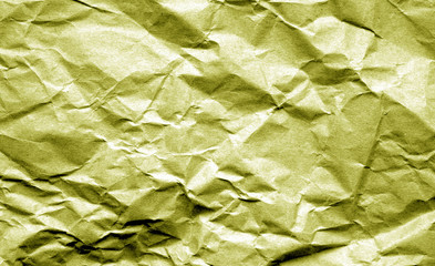 Old crumpled paper with wrinckles in yellow color.