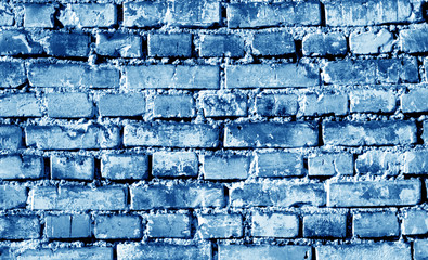Grungy weahered brick wall in navy blue tone.