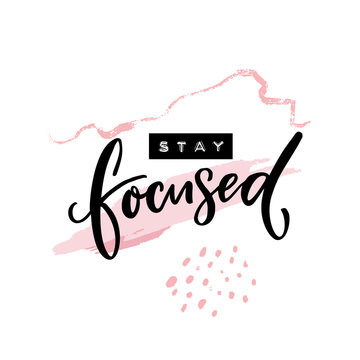 Stay focused inscription. Motivational quote, handwritten calligraphy and embossed tape text on abstract pink brush strokes. Poster print design.
