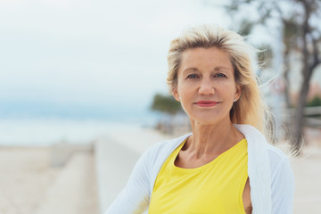 Attractive blond woman on a breezy beach
