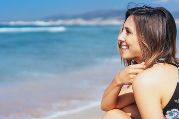 Happy young woman relaxing a the beach