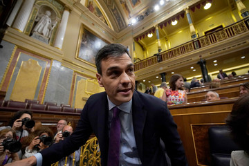 Spain's Prime Minister Pedro Sanchez arrives for a cabinet control session at Parliament in Madrid