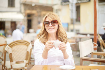Woman relaxing at outdoor cafe