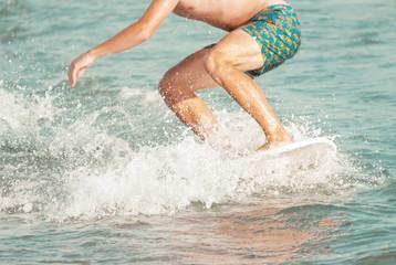 Skimboarding ocean