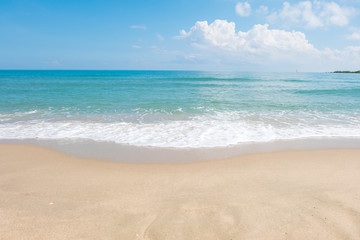 HDR shot of sea shore with wave and white sand during summer day in thailand (selective focus and white balance / color tone shift )