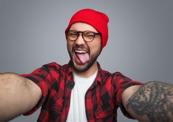 Rebel hipster guy taking selfie