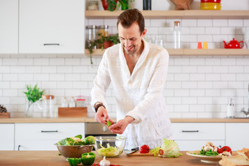 Photo of brunet cooking dinner on table